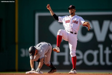 BOSTON, MA - AUGUST 4: Xander Bogaerts #2 of the Boston Red Sox turns a double play over Brett Gardner #11 of the New York Yankees during the fourth inning of a game on August 4, 2018 at Fenway Park in Boston, Massachusetts. (Photo by Billie Weiss/Boston Red Sox/Getty Images) *** Local Caption *** Xander Bogaerts; Brett Gardner