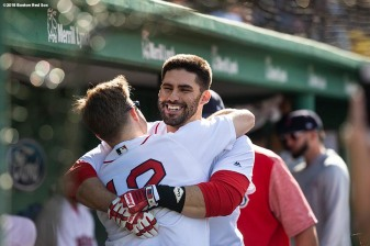 BOSTON, MA - AUGUST 4: J.D. Martinez #28 of the Boston Red Sox hugs Brock Holt #12 after hitting a solo home run during the fourth inning of a game against the New York Yankees on August 4, 2018 at Fenway Park in Boston, Massachusetts. (Photo by Billie Weiss/Boston Red Sox/Getty Images) *** Local Caption *** J.D. Martinez; Brock Holt