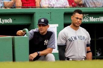 BOSTON, MA - AUGUST 4: Manager Aaron Boone and Giancarlo Stanton #27 of the New York Yankees look on during the ninth inning of a game against the Boston Red Sox on August 4, 2018 at Fenway Park in Boston, Massachusetts. (Photo by Billie Weiss/Boston Red Sox/Getty Images) *** Local Caption *** Aaron Boone; Giancarlo Stanton