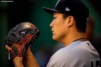 BOSTON, MA - AUGUST 5: Masahiro Tanaka #19 of the New York Yankees warms up before a game against the Boston Red Sox on August 5, 2018 at Fenway Park in Boston, Massachusetts. (Photo by Billie Weiss/Boston Red Sox/Getty Images) *** Local Caption *** Masahiro Tanaka