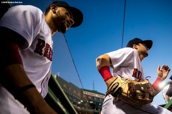 BOSTON, MA - AUGUST 5: Mookie Betts #50 and Andrew Benintendi #16 of the Boston Red Sox run onto the field before a game against the New York Yankees on August 5, 2018 at Fenway Park in Boston, Massachusetts. (Photo by Billie Weiss/Boston Red Sox/Getty Images) *** Local Caption *** Mookie Betts; Andrew Benintendi