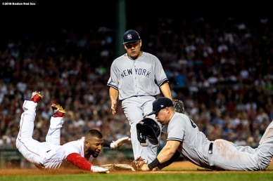 BOSTON, MA - AUGUST 5: Eduardo Nunez #36 of the Boston Red Sox dives as he beats out as Masahiro Tanaka #19 and Luke Voit #45 of the New York Yankees cover the base during the second inning of a game on August 5, 2018 at Fenway Park in Boston, Massachusetts. (Photo by Billie Weiss/Boston Red Sox/Getty Images) *** Local Caption *** Xander Bogaerts; Luke Voit; Masahiro Tanaka