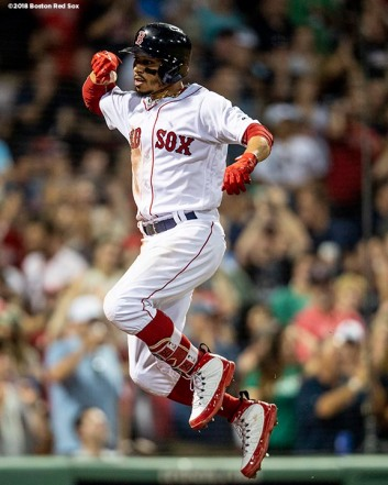 BOSTON, MA - AUGUST 5: Mookie Betts #50 of the Boston Red Sox reacts after hitting a solo home run during the fifth inning of a game against the New York Yankees on August 5, 2018 at Fenway Park in Boston, Massachusetts. (Photo by Billie Weiss/Boston Red Sox/Getty Images) *** Local Caption *** Mookie Betts