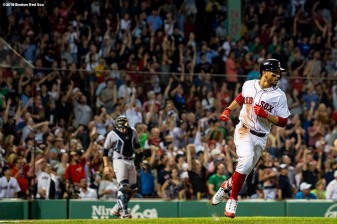 BOSTON, MA - AUGUST 5: Mookie Betts #50 of the Boston Red Sox rounds the bases after hitting a solo home run during the fifth inning of a game against the New York Yankees on August 5, 2018 at Fenway Park in Boston, Massachusetts. (Photo by Billie Weiss/Boston Red Sox/Getty Images) *** Local Caption *** Mookie Betts