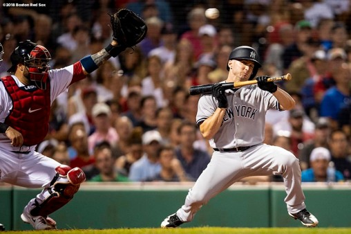 BOSTON, MA - AUGUST 5: Shane Robinson #38 of the New York Yankees ducks out of the way as he prepares to bunt against Heath Hembree #37 of the Boston Red Sox during the seventh inning of a game on August 5, 2018 at Fenway Park in Boston, Massachusetts. (Photo by Billie Weiss/Boston Red Sox/Getty Images) *** Local Caption *** Shane Robinson