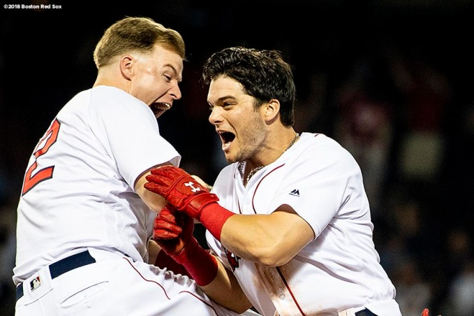 BOSTON, MA - AUGUST 5: Andrew Benintendi #16 of the Boston Red Sox reacts with Brock Holt #12 after hitting the game winning walk off single during the tenth inning of a game against the New York Yankees on August 5, 2018 at Fenway Park in Boston, Massachusetts. (Photo by Billie Weiss/Boston Red Sox/Getty Images) *** Local Caption *** Andrew Benintendi; Brock Holt