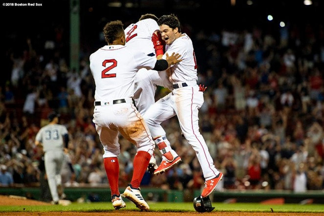 BOSTON, MA - AUGUST 5: Andrew Benintendi #16 of the Boston Red Sox reacts with Brock Holt #12 and Xander Bogaerts #2 after hitting the game winning walk off single during the tenth inning of a game against the New York Yankees on August 5, 2018 at Fenway Park in Boston, Massachusetts. (Photo by Billie Weiss/Boston Red Sox/Getty Images) *** Local Caption *** Andrew Benintendi; Brock Holt; Xander Bogaerts