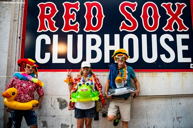 August 9, 2018, Boston, MA: Fans pose for a photograph during a Jimmy Buffett concert at Fenway Park in Boston, Massachusetts Thursday, August 9, 2018. (Photo by Billie Weiss/Boston Red Sox)