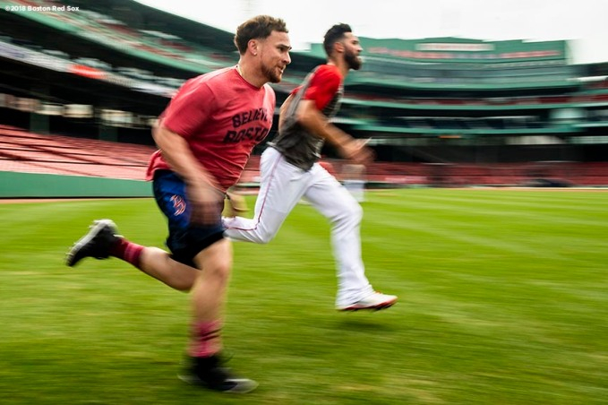 BOSTON, MA - AUGUST 17: Christian Vazquez #7 and Rick Porcello #22 of the Boston Red Sox run sprints before a game against the Tampa Bay Rays on August 17, 2018 at Fenway Park in Boston, Massachusetts. (Photo by Billie Weiss/Boston Red Sox/Getty Images) *** Local Caption *** Christian Vazquez; Rick Porcello