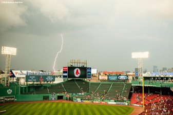 BOSTON, MA - AUGUST 17: Lightning strikes before a game between the Boston Red Sox and the Tampa Bay Rays on August 17, 2018 at Fenway Park in Boston, Massachusetts. (Photo by Billie Weiss/Boston Red Sox/Getty Images) *** Local Caption ***