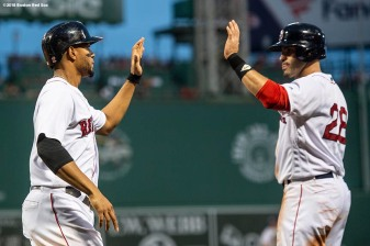 BOSTON, MA - AUGUST 18: Xander Bogaerts #2 of the Boston Red Sox high fives J.D. Martinez #28 as he scores during the first inning of a game against the Tampa Bay Rays on August 18, 2018 at Fenway Park in Boston, Massachusetts. (Photo by Billie Weiss/Boston Red Sox/Getty Images) *** Local Caption *** Xander Bogaerts; J.D. Martinez
