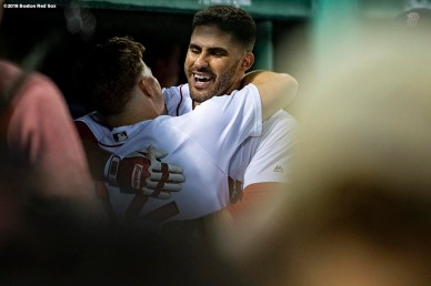 BOSTON, MA - AUGUST 18: J.D. Martinez #28 of the Boston Red Sox hugs Brock Holt #12 after hitting a solo home run during the third inning of a game against the Tampa Bay Rays on August 18, 2018 at Fenway Park in Boston, Massachusetts. (Photo by Billie Weiss/Boston Red Sox/Getty Images) *** Local Caption *** J.D. Martinez; Brock Holt
