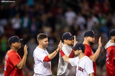 BOSTON, MA - AUGUST 18: Andrew Benintendi #16 of the Boston Red Sox high fives teammates after a victory against the Tampa Bay Rays on August 18, 2018 at Fenway Park in Boston, Massachusetts. (Photo by Billie Weiss/Boston Red Sox/Getty Images) *** Local Caption *** Andrew Benintendi