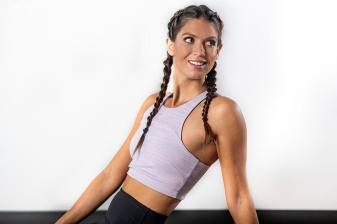 """Blogger Carolyn Pomeranz poses for a photograph at CorePower Yoga in Boston, Massachusetts."""