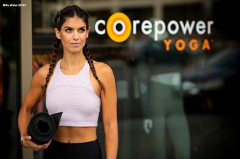 """Blogger Carolyn Pomeranz poses for a photograph at CorePower Yoga in Boston, Massachusetts."""