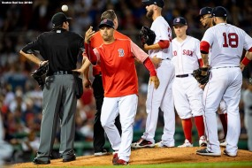BOSTON, MA - AUGUST 20: Manager Alex Cora tosses a ball as a trainer tends to Rick Porcello #22 of the Boston Red Sox after being hit with a line drive during the seventh inning of a game against the Cleveland Indians on August 20, 2018 at Fenway Park in Boston, Massachusetts. (Photo by Billie Weiss/Boston Red Sox/Getty Images) *** Local Caption *** Rick Porcello; Alex Cora