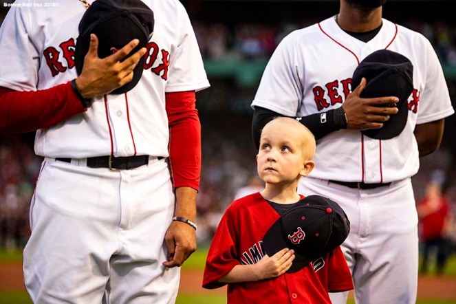 BOSTON, MA - AUGUST 21: A young Jimmy Fund patient looks on as he takes the field with Mookie Betts #50 and Jackie Bradley Jr. #19 of the Boston Red Sox before a game against the Cleveland Indians on August 21, 2018 at Fenway Park in Boston, Massachusetts. (Photo by Billie Weiss/Boston Red Sox/Getty Images) *** Local Caption *** Jackie Bradley Jr.; Mookie Betts