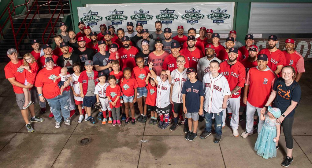 August 22, 2018, Boston, MA: Members of the Boston Red Sox pose for a team photograph with patients of the Jimmy Fund during the 2018 WEEI-NESN Jimmy Fund Radio Telethon at Fenway Park in Boston, Massachusetts Wednesday, August 22, 2018. (Photo by Billie Weiss/Boston Red Sox)