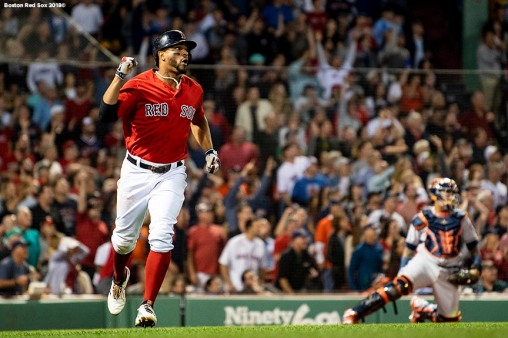 BOSTON, MA - SEPTEMBER 7: Xander Bogaerts #2 of the Boston Red Sox reacts after hitting a solo home run during the fourth inning of a game against the Houston Astros on September 7, 2018 at Fenway Park in Boston, Massachusetts. (Photo by Billie Weiss/Boston Red Sox/Getty Images) *** Local Caption *** Xander Bogaerts