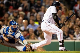 BOSTON, MA - SEPTEMBER 12: Jackie Bradley Jr. #19 of the Boston Red Sox checks his swing as a pitch gets passed Danny Jansen #9 of the Toronto Blue Jays during the fifth inning of a game on September 12, 2018 at Fenway Park in Boston, Massachusetts. (Photo by Billie Weiss/Boston Red Sox/Getty Images) *** Local Caption *** Danny Jansen; Jackie Bradley Jr.