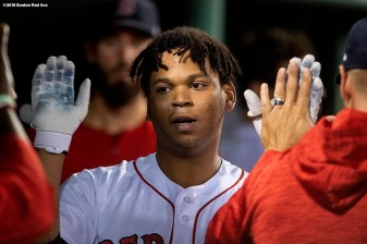 BOSTON, MA - SEPTEMBER 13: Rafael Devers #1 of the Boston Red Sox high fives teammates after hitting a solo home run during the sixth inning of a game against the Toronto Blue Jays on September 13, 2018 at Fenway Park in Boston, Massachusetts. (Photo by Billie Weiss/Boston Red Sox/Getty Images) *** Local Caption *** Rafael Devers