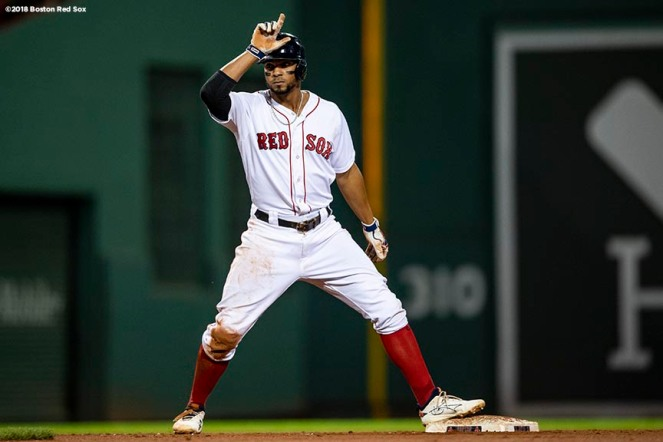 BOSTON, MA - SEPTEMBER 13: Xander Bogaerts #2 of the Boston Red Sox reacts after hitting a double during the eighth inning of a game against the Toronto Blue Jays on September 13, 2018 at Fenway Park in Boston, Massachusetts. (Photo by Billie Weiss/Boston Red Sox/Getty Images) *** Local Caption *** Xander Bogaerts