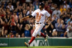 BOSTON, MA - SEPTEMBER 13: Xander Bogaerts #2 of the Boston Red Sox reacts after scoring during the eighth inning of a game against the Toronto Blue Jays on September 13, 2018 at Fenway Park in Boston, Massachusetts. (Photo by Billie Weiss/Boston Red Sox/Getty Images) *** Local Caption *** Xander Bogaerts