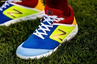 BOSTON, MA - SEPTEMBER 13: Brock Holt #12 of the Boston Red Sox wears special New Balance cleats in recognition of a Go Gold For Cancer childhood cancer awareness pre-game ceremony before a game between the Boston Red Sox and the Toronto Blue Jays on September 13, 2018 at Fenway Park in Boston, Massachusetts. (Photo by Billie Weiss/Boston Red Sox/Getty Images) *** Local Caption *** Brock Holt