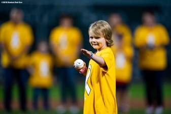 BOSTON, MA - SEPTEMBER 13: Patient Avery Smith throws out a ceremonial first pitch during a Go Gold For Cancer childhood cancer awareness pre-game ceremony before a game between the Boston Red Sox and the Toronto Blue Jays on September 13, 2018 at Fenway Park in Boston, Massachusetts. (Photo by Billie Weiss/Boston Red Sox/Getty Images) *** Local Caption *** Avery Smith