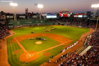 BOSTON, MA - SEPTEMBER 13: A human ribbon of child cancer patients and their families is formed during a Go Gold For Cancer childhood cancer awareness pre-game ceremony before a game between the Boston Red Sox and the Toronto Blue Jays on September 13, 2018 at Fenway Park in Boston, Massachusetts. (Photo by Billie Weiss/Boston Red Sox/Getty Images) *** Local Caption ***
