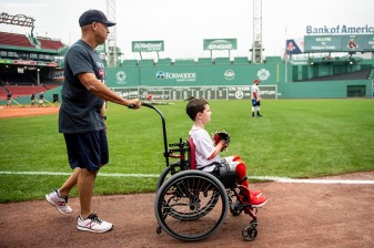 BOSTON, MA - SEPTEMBER 15: Manager Alex Cora of the Boston Red Sox walks on the field with Shriners Hospital patient Sam Halpern before a game against the New York Mets on September 15, 2018 at Fenway Park in Boston, Massachusetts. (Photo by Billie Weiss/Boston Red Sox/Getty Images) *** Local Caption *** Alex Cora; Sam Halpern