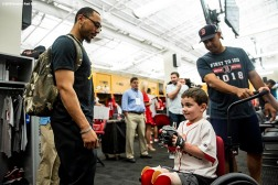 BOSTON, MA - SEPTEMBER 15: Manager Alex Cora of the Boston Red Sox and Mookie Betts #50 greet Shriners Hospital patient Sam Halpern before a game against the New York Mets on September 15, 2018 at Fenway Park in Boston, Massachusetts. (Photo by Billie Weiss/Boston Red Sox/Getty Images) *** Local Caption *** Alex Cora; Sam Halpern; Mookie Betts