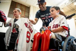 BOSTON, MA - SEPTEMBER 15: Manager Alex Cora of the Boston Red Sox gives a custom jersey to Shriners Hospital patient Sam Halpern and brother Ben Halpern before a game against the New York Mets on September 15, 2018 at Fenway Park in Boston, Massachusetts. (Photo by Billie Weiss/Boston Red Sox/Getty Images) *** Local Caption *** Alex Cora; Sam Halpern; Ben Halpern