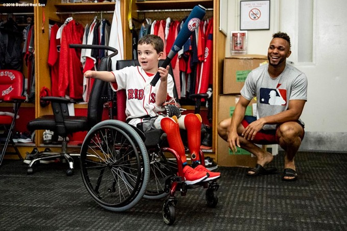 BOSTON, MA - SEPTEMBER 15: Shriners Hospital patient Sam Halpern plays with a baseball bat with Xander Bogaerts #2 of the Boston Red Sox in the clubhouse before a game against the New York Mets on September 15, 2018 at Fenway Park in Boston, Massachusetts. (Photo by Billie Weiss/Boston Red Sox/Getty Images) *** Local Caption *** Xander Bogaerts; Sam Halpern