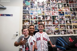 BOSTON, MA - SEPTEMBER 15: Shriners Hospital patient Sam Halpern and his brother Ben pose for a photograph with Xander Bogaerts #2 of the Boston Red Sox in the clubhouse before a game against the New York Mets on September 15, 2018 at Fenway Park in Boston, Massachusetts. (Photo by Billie Weiss/Boston Red Sox/Getty Images) *** Local Caption *** Xander Bogaerts; Sam Halpern