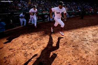 BOSTON, MA - SEPTEMBER 15: Mookie Betts #50 and Andrew Benintendi #16 of the Boston Red Sox run onto the field before a game against the New York Mets on September 15, 2018 at Fenway Park in Boston, Massachusetts. (Photo by Billie Weiss/Boston Red Sox/Getty Images) *** Local Caption *** Mookie Betts; Andrew Benintendi