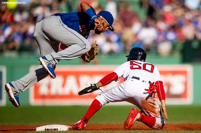 BOSTON, MA - SEPTEMBER 15: Mookie Betts #50 of the Boston Red Sox slides into second base as Amed Rosario #1 of the New York Mets jumps to attempt to catch an overthrown ball during the first inning of a game against the New York Mets on September 15, 2018 at Fenway Park in Boston, Massachusetts. (Photo by Billie Weiss/Boston Red Sox/Getty Images) *** Local Caption *** Mookie Betts; Amed Rosario