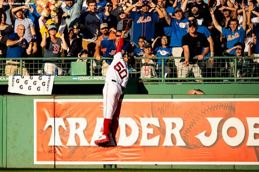BOSTON, MA - SEPTEMBER 15: Mookie Betts #50 of the Boston Red Sox attempts to catch a three run home run ball hit by Brandon Nimmo #9 of the New York Mets during the third inning of a game on September 15, 2018 at Fenway Park in Boston, Massachusetts. (Photo by Billie Weiss/Boston Red Sox/Getty Images) *** Local Caption *** Mookie Betts