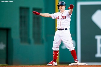 BOSTON, MA - SEPTEMBER 15: Brock Holt #12 of the Boston Red Sox reacts after hitting a pinch hit go-ahead RBI double during the fifth inning of a game against the New York Mets on September 15, 2018 at Fenway Park in Boston, Massachusetts. (Photo by Billie Weiss/Boston Red Sox/Getty Images) *** Local Caption *** Brock Holt