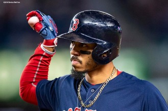 NEW YORK, NY - SEPTEMBER 20: Mookie Betts #50 of the Boston Red Sox reacts to first base after hitting an RBI single during the second inning of a game against the New York Yankees on September 20, 2018 at Yankee Stadium in the Bronx borough of New York City. (Photo by Billie Weiss/Boston Red Sox/Getty Images) *** Local Caption *** Mookie Betts
