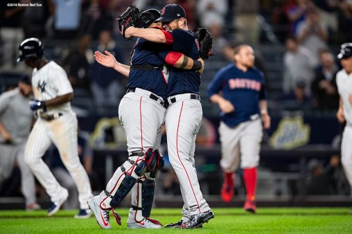 NEW YORK, NY - SEPTEMBER 20: Craig Kimbrel #46 and Sandy Leon #3 of the Boston Red Sox celebrate as they clinch the American League East division after a victory against the New York Yankees on September 20, 2018 at Yankee Stadium in the Bronx borough of New York City. (Photo by Billie Weiss/Boston Red Sox/Getty Images) *** Local Caption *** Craig Kimbrel; Sandy Leon