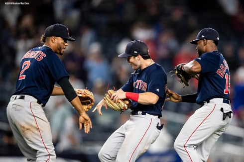 NEW YORK, NY - SEPTEMBER 20: Andrew Benintendi #16, Jackie Bradley Jr. #19, and Xander Bogaerts #2 of the Boston Red Sox celebrate as they clinch the American League East division after a victory against the New York Yankees on September 20, 2018 at Yankee Stadium in the Bronx borough of New York City. (Photo by Billie Weiss/Boston Red Sox/Getty Images) *** Local Caption *** Andrew Benintendi, Jackie Bradley Jr., Xander Bogaerts
