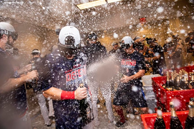 NEW YORK, NY - SEPTEMBER 20: Members of the Boston Red Sox celebrate in the clubhouse after clinching the American League East division following a victory against the New York Yankees on September 20, 2018 at Yankee Stadium in the Bronx borough of New York City. (Photo by Billie Weiss/Boston Red Sox/Getty Images) *** Local Caption ***