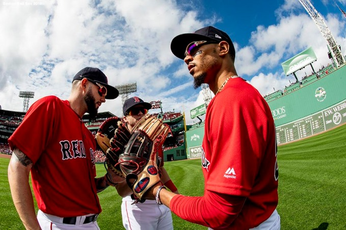 BOSTON, MA - SEPTEMBER 26: Blake Swihart #23, Mookie Betts #50, and Andrew Benintendi #16 of the Boston Red Sox high five before a game against the Baltimore Orioles on September 26, 2018 at Fenway Park in Boston, Massachusetts. (Photo by Billie Weiss/Boston Red Sox/Getty Images) *** Local Caption *** Blake Swihart; Andrew Benintendi; Mookie Betts