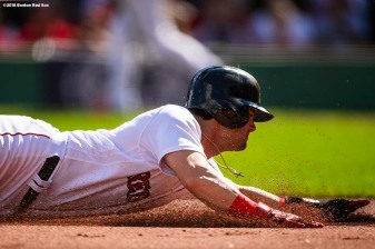BOSTON, MA - SEPTEMBER 29: Andrew Benintendi #16 of the Boston Red Sox slides into third base during the first inning of a game against the New York Yankees on September 29, 2018 at Fenway Park in Boston, Massachusetts. (Photo by Billie Weiss/Boston Red Sox/Getty Images) *** Local Caption *** Andrew Benintendi