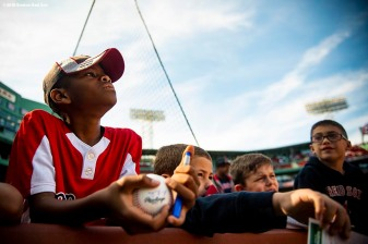 BOSTON, MA - SEPTEMBER 30: Young fans look on before a game between of the Boston Red Sox and the New York Yankees on September 30, 2018 at Fenway Park in Boston, Massachusetts. (Photo by Billie Weiss/Boston Red Sox/Getty Images) *** Local Caption ***