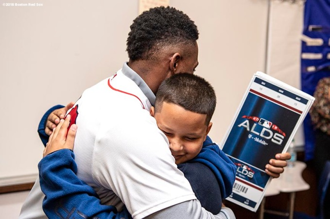 BRIGHTON, MA - SEPTEMBER 30: Student Lucas Feliciano reacts as Jackie Bradley Jr. #19 of the Boston Red Sox surprises him with American League Division Series tickets during a visit to Boston Green Academy on October 1, 2018 in Brighton, Massachusetts. (Photo by Billie Weiss/Boston Red Sox/Getty Images) *** Local Caption *** Jackie Bradley Jr.