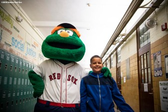 BRIGHTON, MA - SEPTEMBER 30: Student Lucas Feliciano walks through the hallway with mascot Wally the Green Monster as Jackie Bradley Jr. #19 of the Boston Red Sox surprises him with American League Division Series tickets during a visit to Boston Green Academy on October 1, 2018 in Brighton, Massachusetts. (Photo by Billie Weiss/Boston Red Sox/Getty Images) *** Local Caption *** Jackie Bradley Jr.