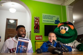 BRIGHTON, MA - SEPTEMBER 30: Student Lucas Feliciano speaks with the media after Jackie Bradley Jr. #19 of the Boston Red Sox and mascot Wally the Green Monster surprised him with American League Division Series tickets during a visit to Boston Green Academy on October 1, 2018 in Brighton, Massachusetts. (Photo by Billie Weiss/Boston Red Sox/Getty Images) *** Local Caption *** Jackie Bradley Jr.