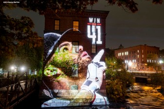 DORCHESTER, MA - OCTOBER 1: An image of J.D. Martinez #28 of the Boston Red Sox is projected onto the Baker Chocolate Factory on October 1, 2018 in Dorchester, Massachusetts. (Photo by Billie Weiss/Boston Red Sox/Getty Images) *** Local Caption *** J.D. Martine